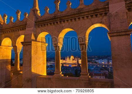 View Of The Fisherman's Bastion Budapest At Night Overlooking The Danube And Parliament Building