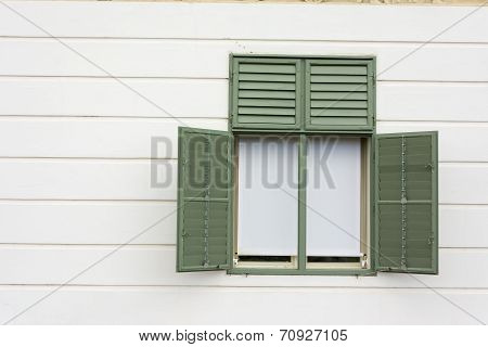 Green Painted Window Frame With White Wall