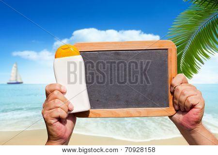 Bottle Suncreen And Blank Slate Blackboard
