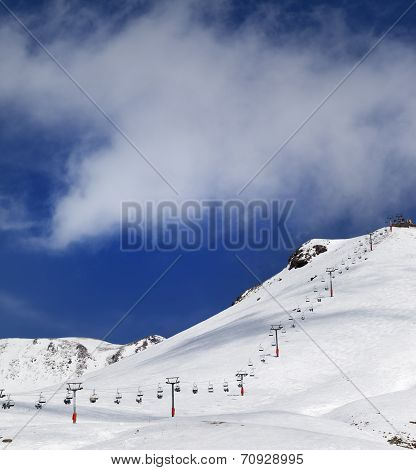 Chair-lift And Ski Slope In Sun Day