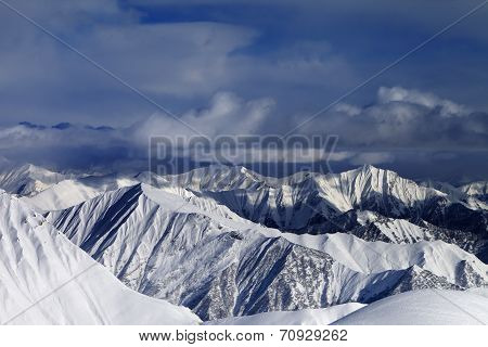 Sunlight Snowy Mountains And Storm Clouds