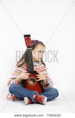 Little Girl Playing Acoustic Guitar