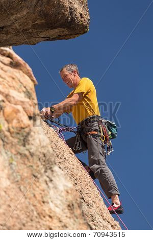 Senior Man At Top Of Rock Climb In Colorado