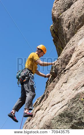 Senior Man On Steep Rock Climb In Colorado
