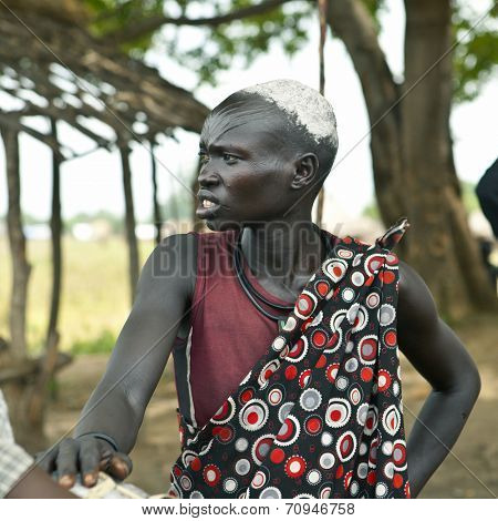 MANGALLA, SOUTH SUDAN-JUNE 22 2012: Unidentified Dinka woman with tribal scarification in South Sudan