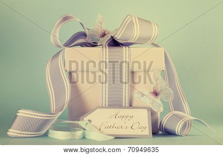 Happy Fathers Day Blue Butterfly Theme Gift With Greeting Gift Tag Against A Blue Background With Re