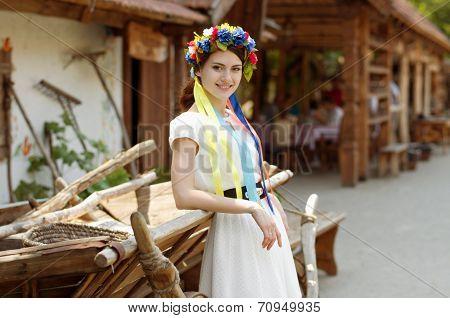 Ukrainian beautiful girl in national chaplet