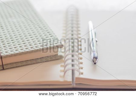 Green Covered Notebook And Pen