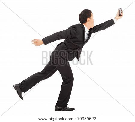 Businessman  Running Busily And Holding A Smart Phone