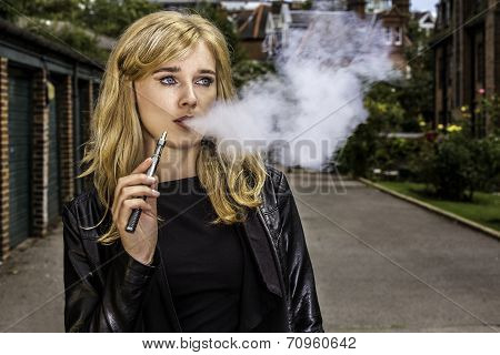 Pretty Woman Smoking An E-cigarette