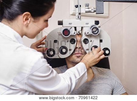 Optometrist Woman Looking Phoropter Calibration
