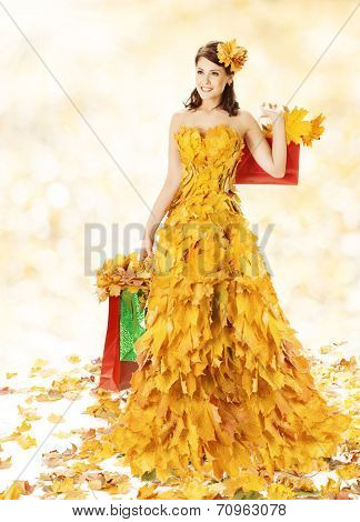 Shopping Woman Happy In Autumn Fashion Dress Of Yellow Fall Leaves With Paper Bags