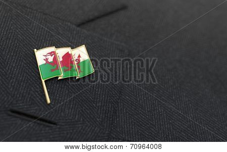 Wales Flag Lapel Pin On The Collar Of A Business Suit