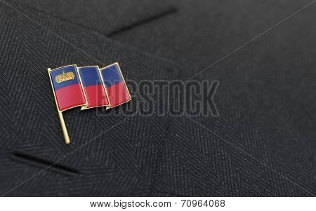 Liechtenstein Flag Lapel Pin On The Collar Of A Business Suit