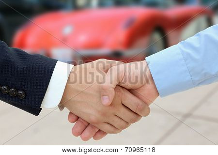Close-up Image Of A Firm Handshake  After A Successful Deal Of Buying A Car