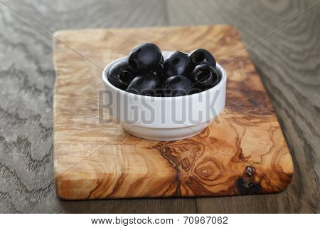 Black Olives From Can In Bowl On Table