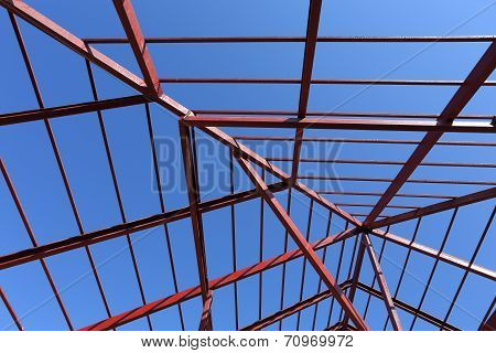 Residential Construction Home, Steel Beams With Blue Sky At Construction Site
