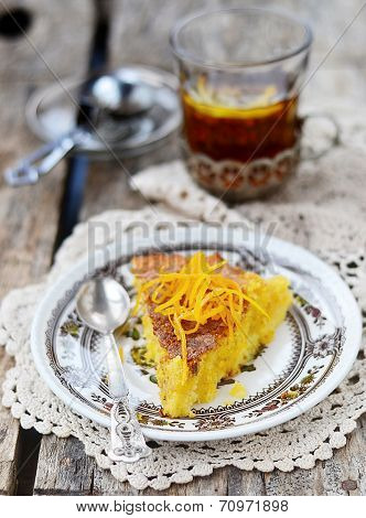 Polenta and citrus cake with cup of tea.