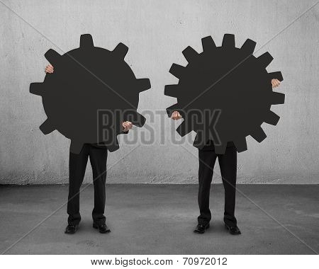 Two Men Holding Their Different Gear