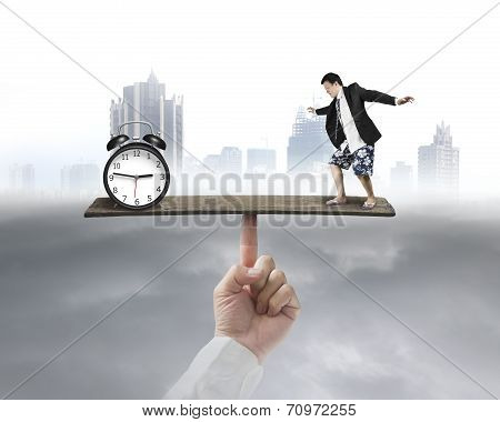 Man Standing On Seesaw Vs Clock