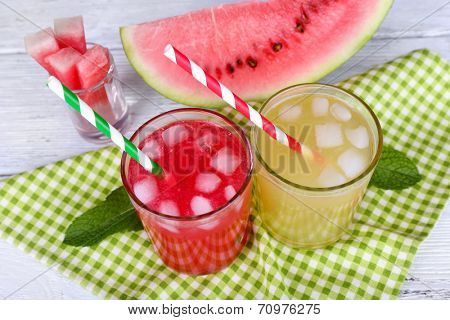 Watermelon cocktail and melon smoothie on wooden table