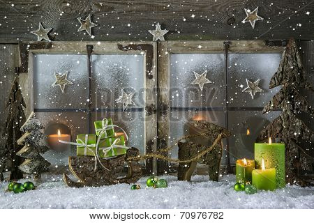 Natural Wooden Christmas Decoration With Candles And Green Presents.