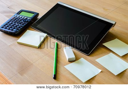Workplace With Tablet Pc, Calculator, Pencil And Sticky Notes