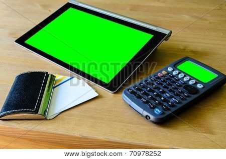 Workplace With Tablet Pc - Green Box, Calculator And Bussiness Card