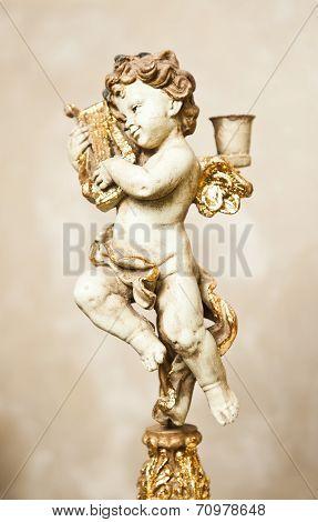 Angel with lyre ornament. Golden ornament. Vintage angel. Ceramic angel playing harp. Cupid