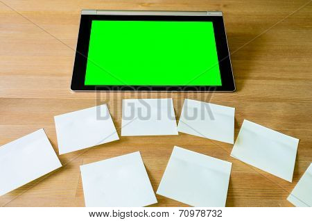 Workplace With Tablet Pc - Green Box - And Several Sticky Notes