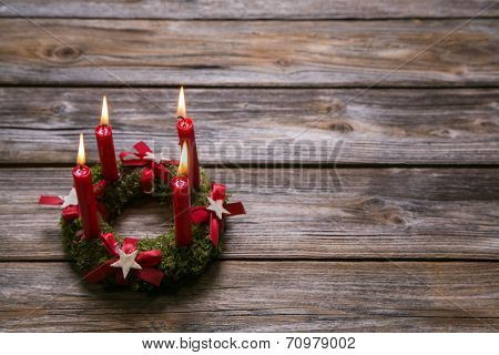 Natural Advent Wreath With Four Red Candles On Wooden Background.