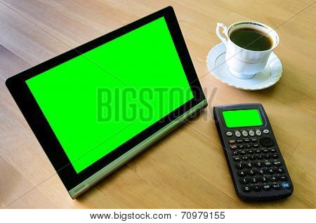 Workplace With Tablet Pc - Green Box, Calculator And Cup Of Coffee
