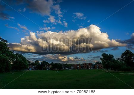 Large Moody Cloud Over Houses
