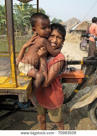 SUNDARBANS, WEST BENGAL, INDIA - JANUARY 18: Sayan Payne, 12, holding his little brother Rajneesh, 3, at remote village in Sundarbans, West Bengal, India on January 18, 2009.