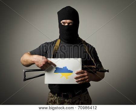 Gunman Is Holding White Paper With A Question About Future Of Ukraine.