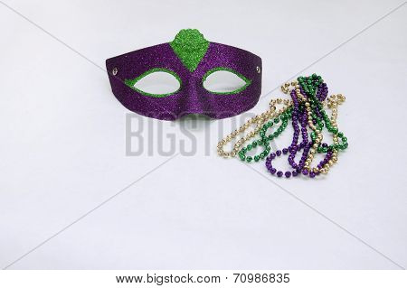 one masquerade mask and beads