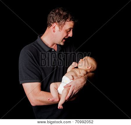 Happy Daddy Holding Baby