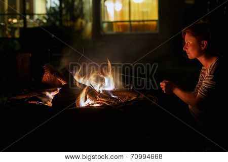 Woman And Bonfire At Night