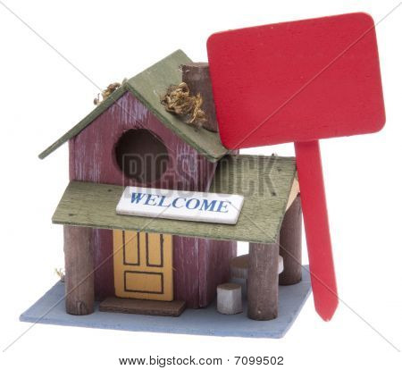Small Farm Home With Red Sign