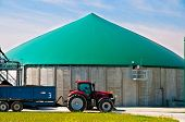 image of biogas  - Red tractor in front of a biogas plant - JPG