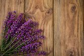 pic of viola  - Purple and viola heather flowers on wooden table