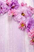 image of chrysanthemum  - beautiful chrysanthemum and artificial eustoma flowers on purple wooden background - JPG