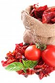 picture of sackcloth  - Sun dried tomatoes in sackcloth bag and basil leaves - JPG
