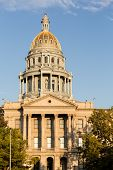 stock photo of granite dome  - The gold leaf covered dome of the State Capitol Dome in Denver Colorado shortly after sunrise - JPG