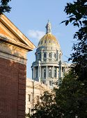 image of granite dome  - The gold leaf covered dome of the State Capitol Dome in Denver Colorado shortly after sunrise - JPG