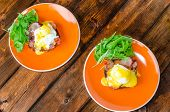 picture of benediction  - English muffin with bacon egg benedict with hollandaise sauce and arugula salad fresh orange juice - JPG