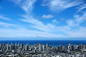picture of waikiki  - Waikiki and Honolulu cityscape roads buildings skyscrapers parks and Pacific Ocean with boats in the water and clouds in the sky on Oahu Hawaii. Metropolitan