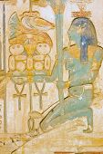 image of isis  - An ancient egyptian painted hieroglyphic carving showing the goddess Isis carrying a tray of food including ducks and bread - JPG