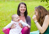 stock photo of babysitter  - Happy mother and daughter with her babysitter - JPG