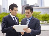 foto of pal  - asian business executives using ipad in city park - JPG
